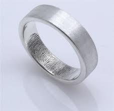 Personalised finger print wedding rings!! LUUURRRV!  http://www.etsy.com/shop/fabuluster