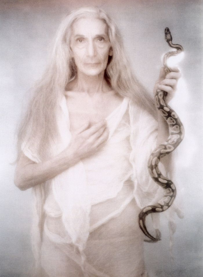 "The serpent is a sign of the Healer, High Priestess, Shamaness, and Visionary. Snake power is a radical power, both dangerous and transformative. The Crone Goddess, rules menopause, ""a powerful time of self-creation and self-government that could produce visions and create magic."" For a woman to use her will and creativity for her own benefit is frightening for some men. (Ellis)  By Joyce Tenneson."