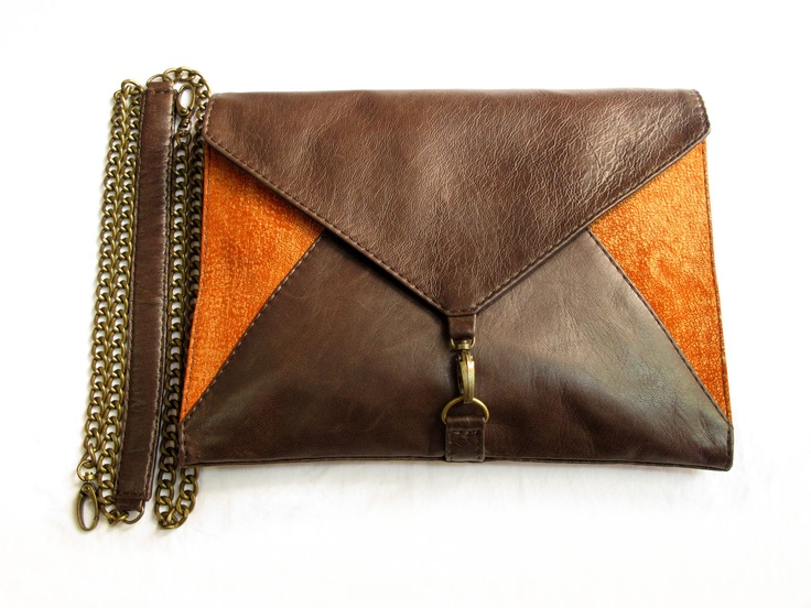 "ENVELOPE clutch in ""worn"" style brown leather and antik orange, with zip pocket and two slip pockets inside, comes with detachable chain with leather strap for more comfort"