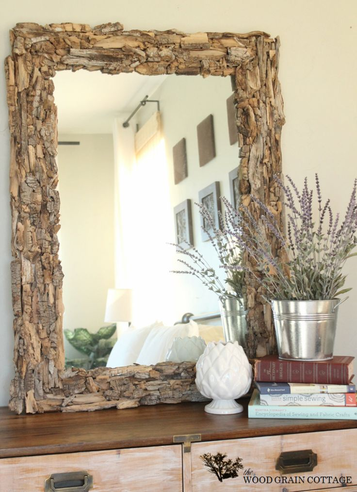 How To Cover A Mirror With Driftwood by The Wood Grain Cottage - this is a creative way to add interest to a plain mirror frame.