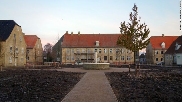 <strong>Christiansfeld, a Moravian Church settlement, Denmark. </strong>Founded in 1773, Christiansfeld is a world-renowned planned settlement of the Moravian Church, which was planned and constructed to represent the Protestant urban ideal of a town built around a central church square. (The church square is shown here.) The buildings are still used by the Moravian Church community.