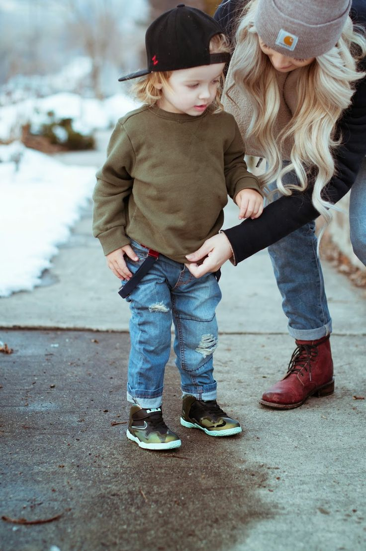 Toddler grunge style. Baby boy skinny jeans, suspenders and olive sweatshirt.