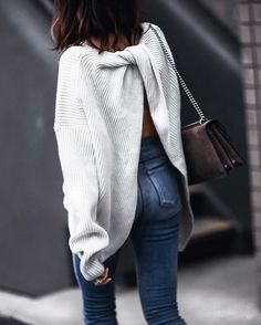 Love this knotted and backless sweater paired with a dark denim! Alaska Style
