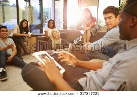 Group Of University Students Relaxing In Common Room - stock photo