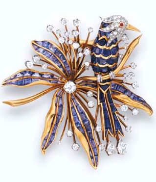 """A RETRO SAPPHIRE, DIAMOND AND GOLD """"PERCHED BIRD"""" BROOCH, BY VAN CLEEF &…"""