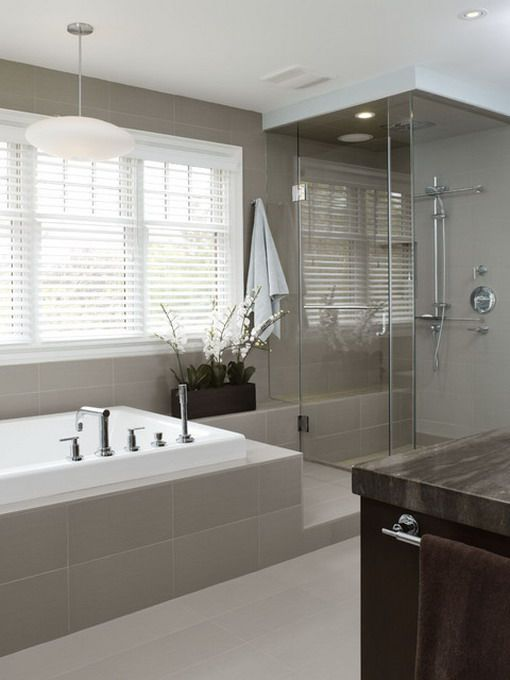 Warm grey bathroom tiles with white furniture