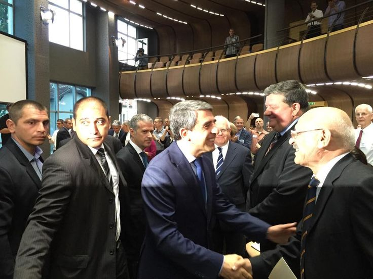Attendees, including State President of Bulgaria Plevneliev, greet one another at the opening event of the European Baptist Federation's 2015 council meeting in Sofia, Bulgaria. Photo by Helle Liht.