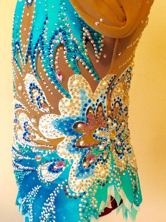 Contains pure Swarovski crystals and pearls. Generally fits girls ages 8-12  Measurements:  Girth- 45.5 Chest- 25 Waist- 20.5 Hips- 25.5 Arm- 20 Neck 12 Skirt- 7.5 front, 8.5 back Inquire about additional information or pictures.  Thank you for your interest, Lana