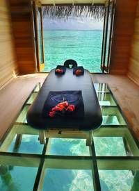 Massage table floating above a glass floor. How's this for a spa room?