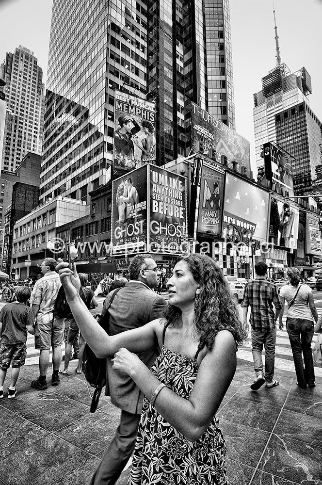 woman taking photo Time Square New York