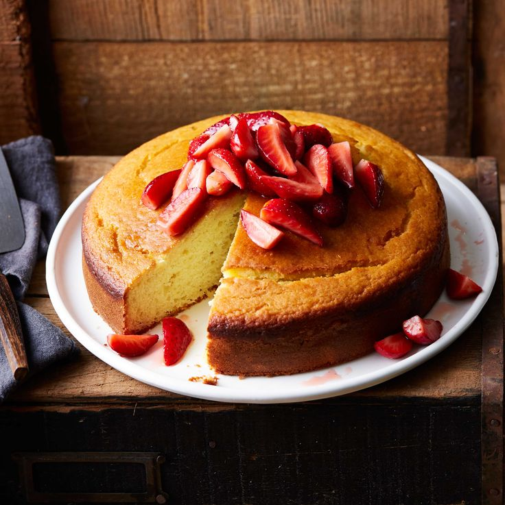 Yoghurt cake with rum-poached strawberries