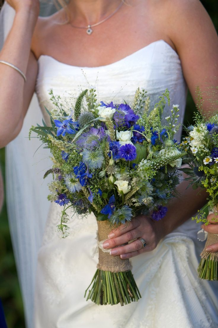 Hessian wrapped bouquet with a blue rustic theme. Conflowers, Scabosia, Delphinium, Panicum, Thlaspi and Wheat.