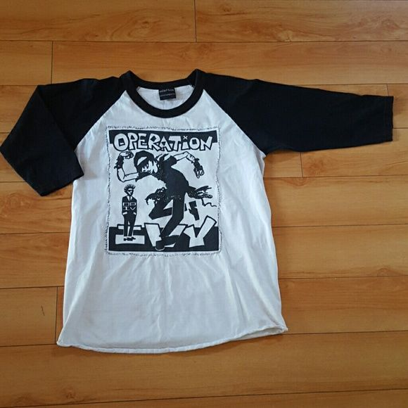 Operation Ivy band baseball shirt In good used condition. Marks on back of shirt (lower left side - as pictured on the last photo). Large black and white image hand-sewn on a black and white baseball tee. Size women's large. Tops Tees - Long Sleeve