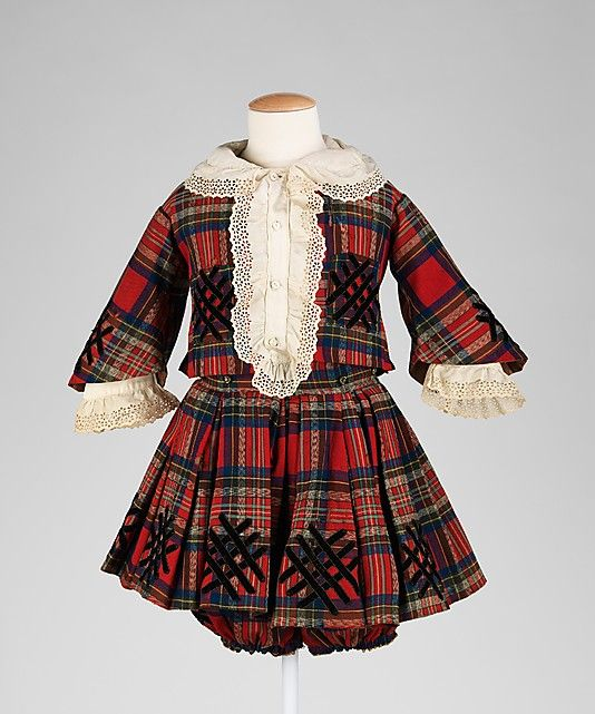 Suit, ca. 1830, American -- The boy's suit seen here mirrors the fashion for plaid which was prevalent at that time, made popular by Queen Victoria and Prince Albert.  A properly dressed boy would have worn an ensemble such as this.  Appropriate for the period, knickers accompanied boy's ensembles with skirts as an alternative to girl's pantalettes.