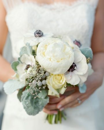 Anemones, seeded eucalyptus, silver brunia, roses, and dusty miller