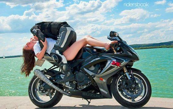 I think this is more funny than sexy - she looks totally uncomfortable and he looks like he's mauling her! Biker fiction @ www.TraceyCramerKelly.com