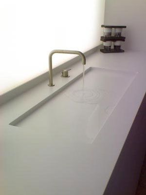 get inspired... bycocoon.com: solid surface washbasin with stainless steel basin mixer Vola KV2