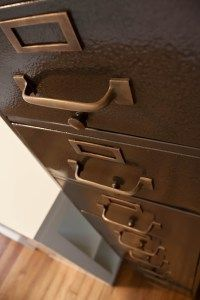 Revamp old file cabinet with brown hammered spray paint and brushed metallic hardware!  Seriously up the wow factor!!!!