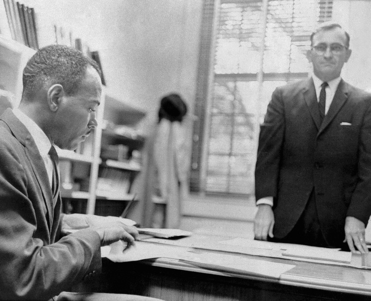 James Meredith is shown as he was registered as a student at the University of Mississippi by Register Robert Ellis in Oxford, Miss., on Oct. 1, 1962. (AP)