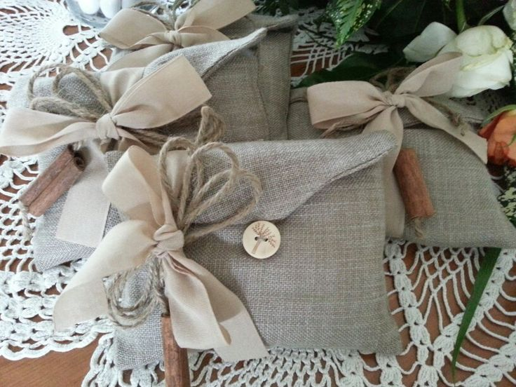 Linen favor ,wooden button, cinnamon stick ,cotton ribbon
