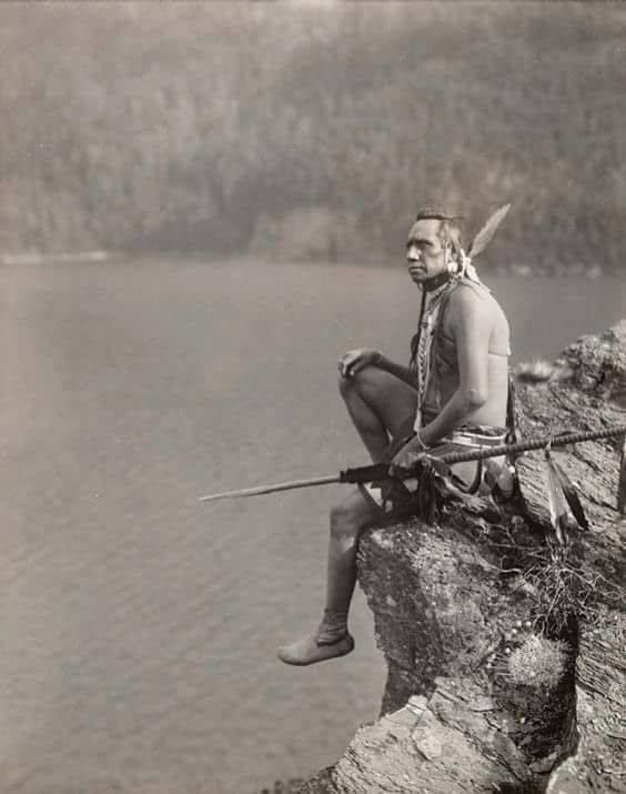 This is one of my very favorite photos. Why? Because it shows this man in his native surroundings. Look at the outcrop and lake below, mountains and sky. How beautiful you are.