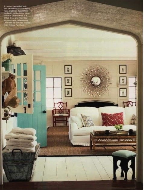 So many details, love the mantel wall, mirror, turquoise door, little box pleated skirt on the sofa