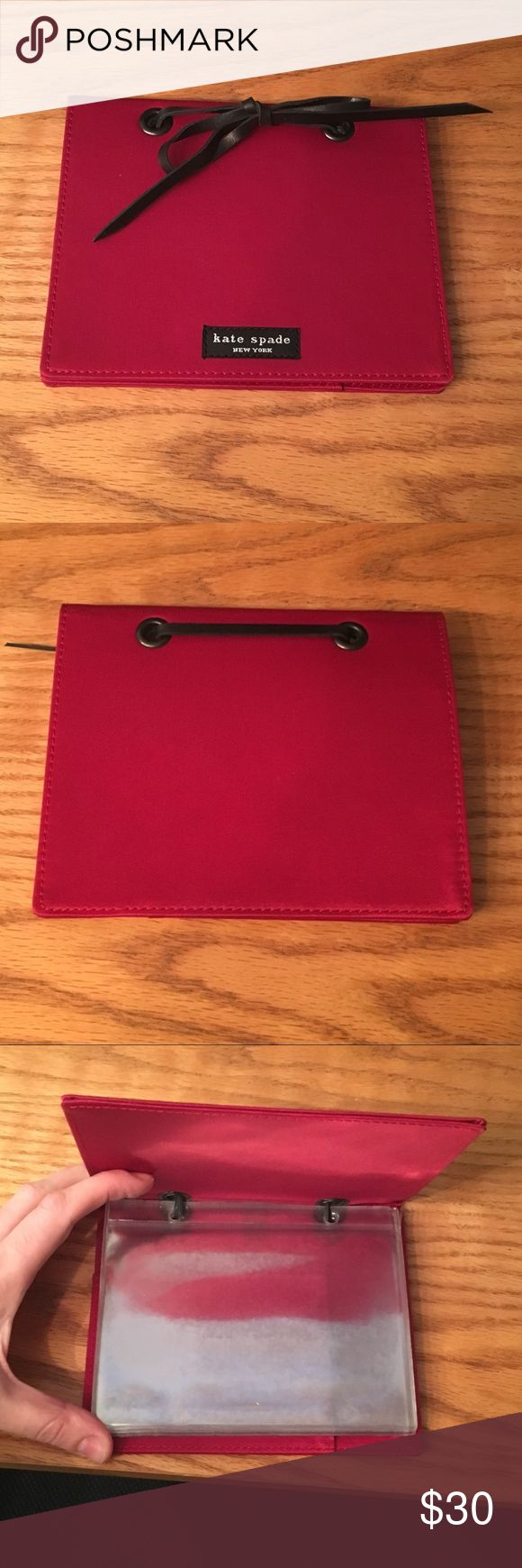 Kate Spade Photo Album NWOT. Cranberry colored nylon photo album with black leather tie. Has 8 clear plastic sleeves that hold 16 4x6 photos. Small pocket located inside of back cover. kate spade Accessories #photoalbum
