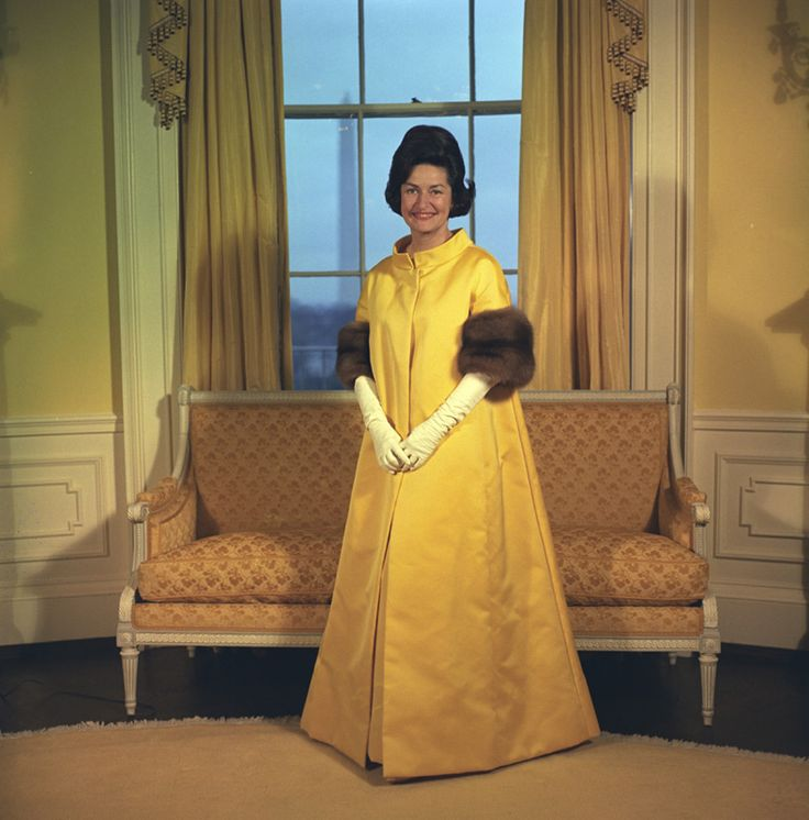Lady Bird Johnson in her inaugural gown, 1965.  There is another picture of her wearing a more form fitting dress.  This could well be the coat that went over her gown.