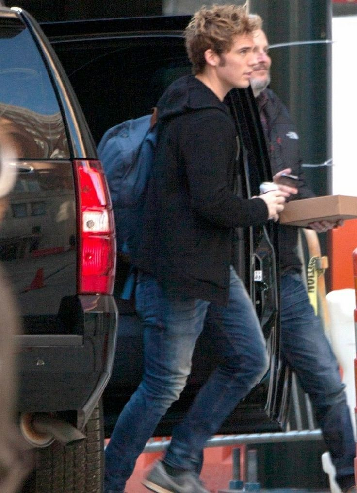 Sam Claflin arrives at the Mockingjay set in Atlanta. You can also barely see Francis Lawrence
