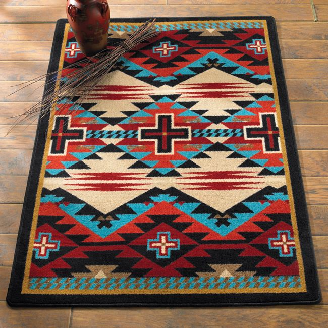 Turquoise and red are always hot in western decorating. Rustic blue cross rug from Lone Star Western Decor