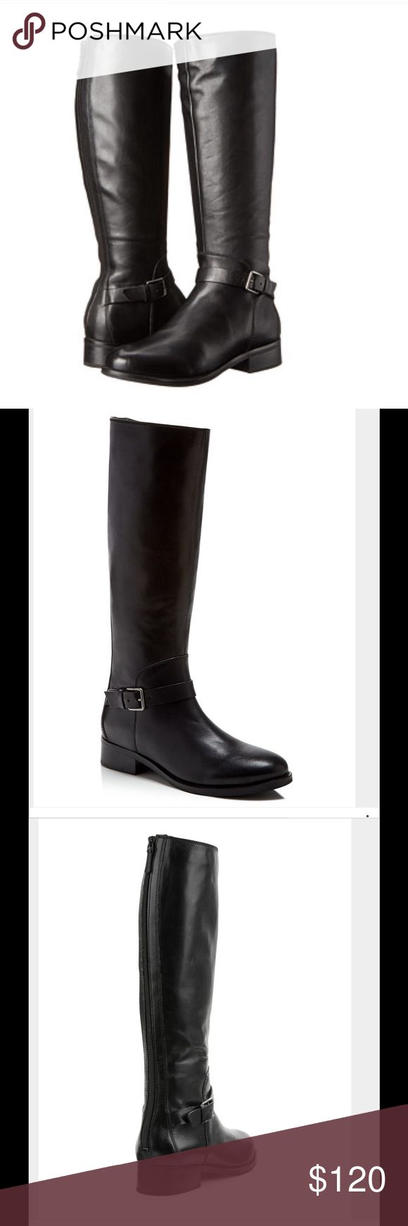 """Cole Haan Black High Boot A back zip closure completes an equestrian-styled tall boot crafted in genuine leather and finished with a standout buckle strap detail. Almond toe, topstitched detail, bottom shaft adjustable buckle strap detail, back zip closure. About 16.5"""" shaft height, 15"""" opening circumference, 1.5"""" heel. Leather upper, manmade sole. Cole Haan Shoes Heeled Boots"""