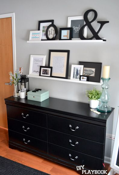 instead of a gallery wall use ikea picture ledges so you can swap out the black furniture decor