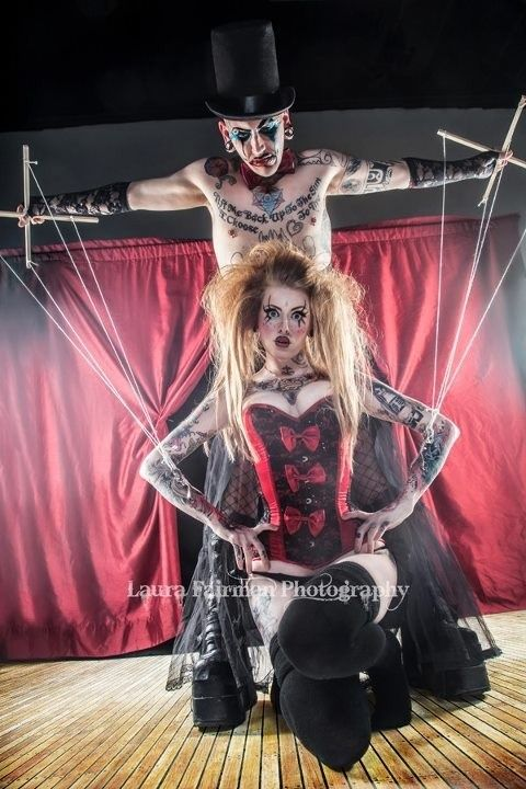 Human Puppet Master With Puppet Marionette On Hooks With