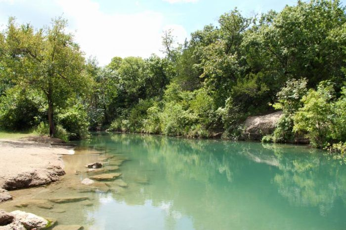 Chickasaw National Recreation Area in Sulphur, Oklahoma is one of the best campings spots in America – full of lush greenery, gorgeous waterfalls and epic scenery.