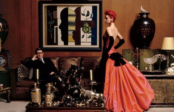 Yves Saint Laurent in the grand salon of his apartment on Rue de Babylone with model Sibyl Buck, October 27, 1995. By Jean-Marie Périer.