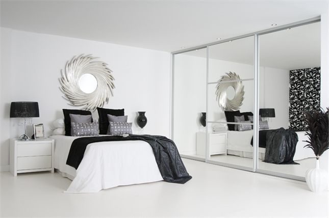 sliding mirror wardrobe and white furniture for the spare room to maximise space and light