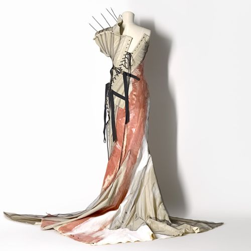 Deconstructionalist Fashion Design -- Clothes that were intentionally destroyed, seams and linings were left on the outside of garments, zippers were exposed, and edges were left unfinished. (Vanessa Leyonhjelm 1994)