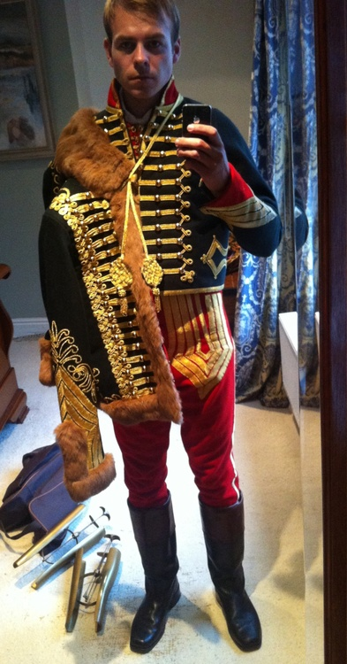 Reproduction of a Napoleonic era French Hussar uniform being worn by a reenactor.