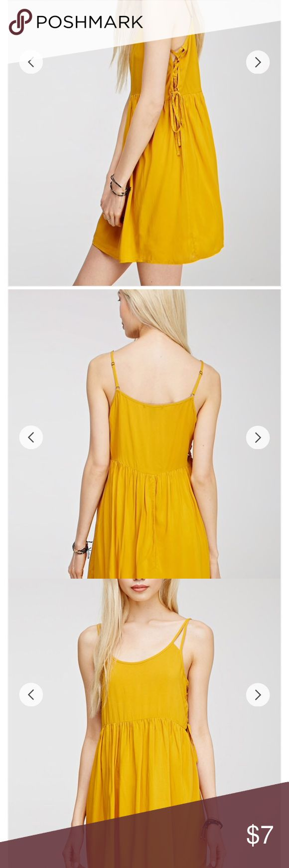 Yellow cami shift dress with criss cross sides NWOT yellow/mustard shift dress with cross-crossed sides. Forever 21 Dresses