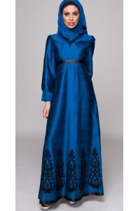 Make a royal interest with this royal blue and black dress.  The embroidery and cut of the sleeves provide a feminine touch. - Habiba West