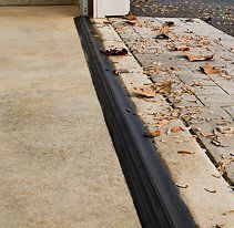 Xtreme WEATHER GUARD GARAGE DOOR THRESHOLDS, Kits and Custom Lengths:  Made in USA from rugged PVC, our threshold adheres to the concrete where the overhead door meets the ground, creating a tight seal to help keep out water, dirt, weather and pests.  Easy do-it-yourself installation. - elite-xpressions.com