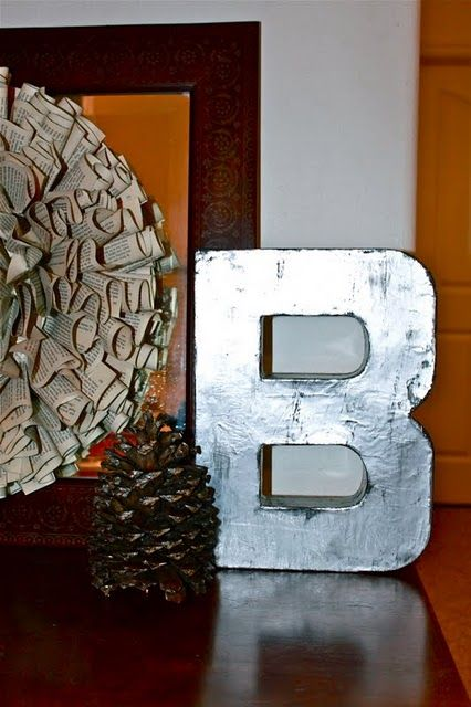 Mod Podge aluminum foil over letter