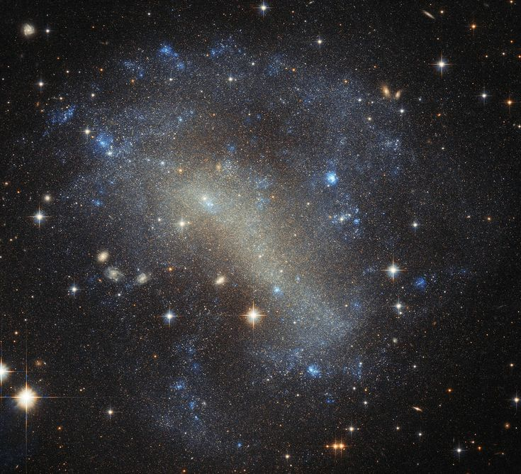 IC 4710 is a dwarf irregular galaxy about 25 million light years away in the southern constellation of Pavo (the Peacock), which also contains contains the third-brightest globular cluster in the sky, NGC 6752, the spiral galaxy NGC 6744, and six known planetary systems (including HD 181433, which is host to a super-Earth). (Credit: ESA/Hubble & NASA, Acknowledgements: Judy Schmidt)