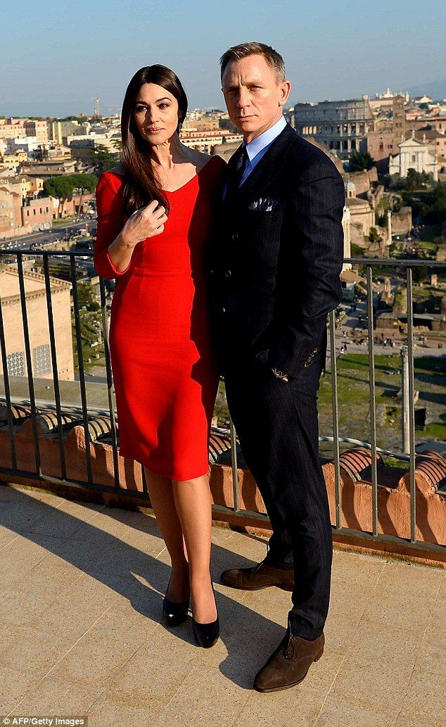Handsome couple: Monica Bellucci (left) and Daniel Craig (right) cut handsome figures for 'SPECTRE' photocall in Rome.