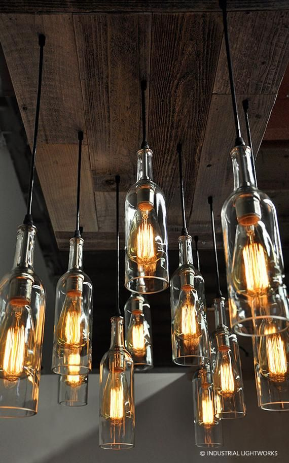 Eleven wine bottle pendant chandelier with a reclaimed wood base. One of a kind …