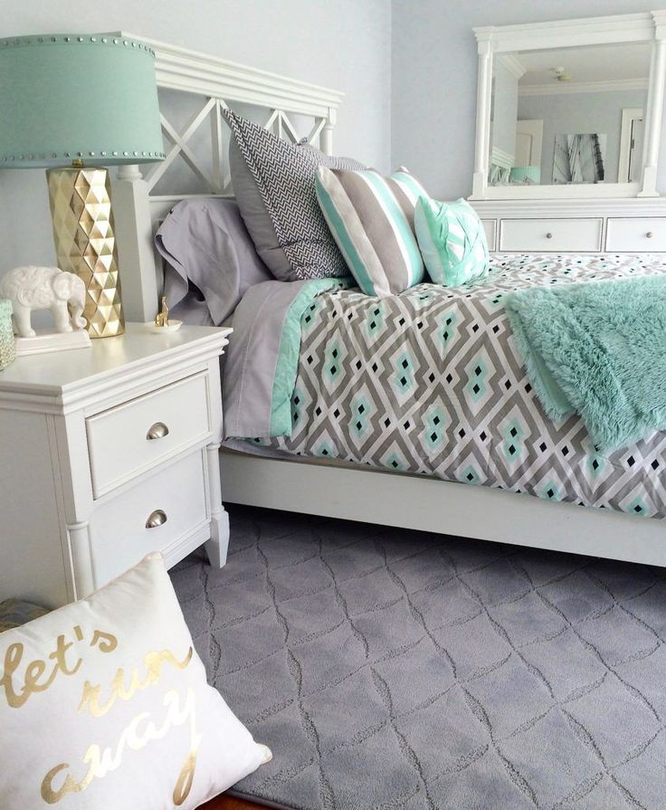 Who doesnt love mint green and gray together? Create a bright and airy bedroom with a touch of gold and layer on the patterns! Happy Chic bedding, faux fur throw blanket, decorative accessories and lighting from HomeGoods. Sponsored Happy By Design Post.