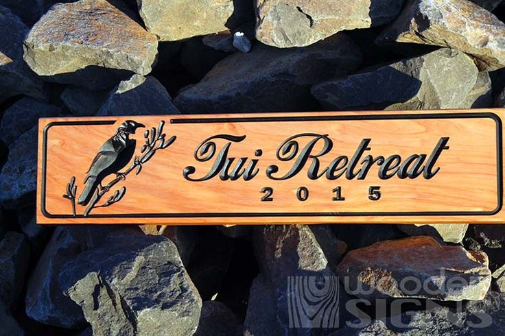 NZ carved wooden macrocarpa sign and a Tui say's it all beautiful.