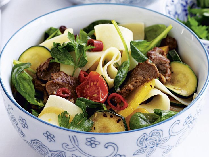 Fill up on zucchini, capsicum, spinach and lamb backstrap with this spicy and easy pasta dish.