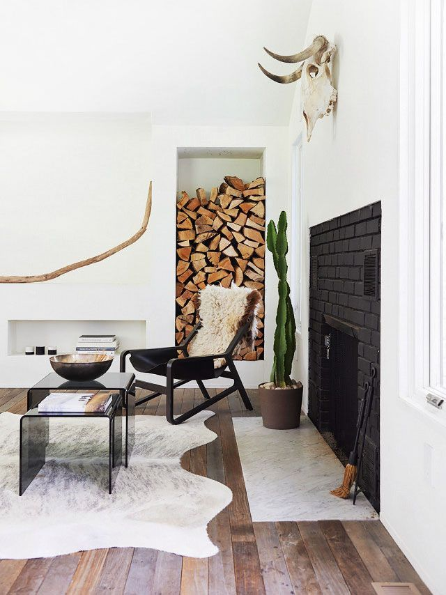 Scandinavian living room design with cowhide rug on Thou Swell @thouswellblog