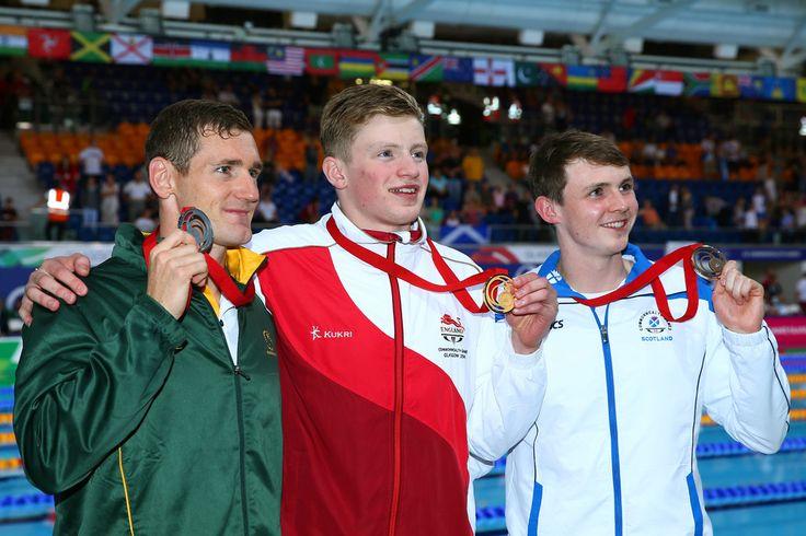 Gold medallist Adam Peaty of England poses with silver medallist Cameron van der Burgh of South Africa and bronze medallist Ross Murdoch of Scotland